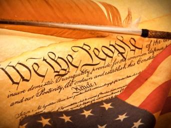 U.S. Constitution with U.S. Flag
